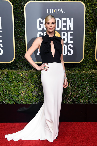 Charlize Theron Cutout Dress [red carpet,carpet,dress,clothing,gown,shoulder,fashion,flooring,premiere,formal wear,arrivals,charlize theron,the beverly hilton hotel,beverly hills,california,golden globe awards]