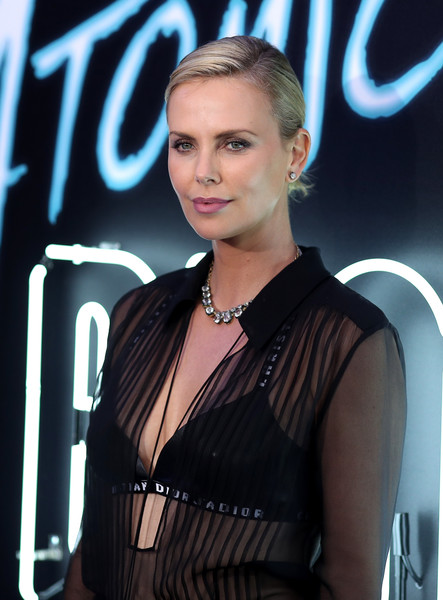 Charlize Theron Bra [hair,beauty,hairstyle,blond,premiere,model,fashion accessory,smile,style,arrivals,charlize theron,atomic blonde,the theatre,los angeles,california,ace hotel,focus features,premiere,premiere]
