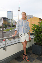 Charlize Theron teamed her shirt with a white zip-front mini skirt, also by Isabel Marant.
