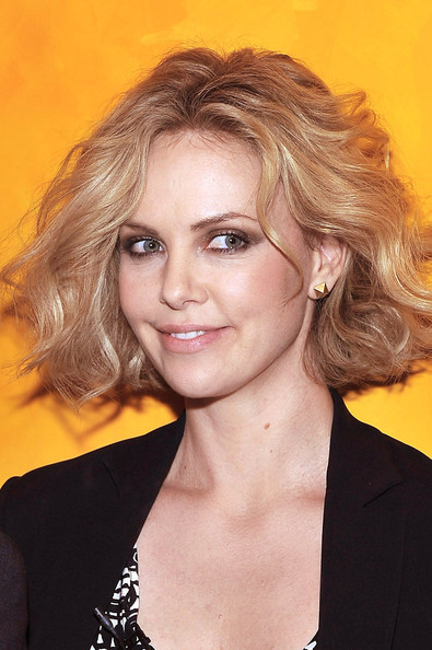 Charlize Theron Short Wavy Cut [timestalks presents a conversation with charlize theron,hair,face,hairstyle,blond,eyebrow,chin,beauty,layered hair,lip,long hair,charlize theron,jason reitman,new york city,times center,new york times timestalk]