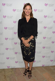 Jennifer Gray sported a simple black silk button-down at the Charlotte and Gwenyth Gray Foundation fundraiser.