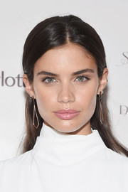 Sara Sampaio wore her hair down with the sides tucked behind her ears when she attended the Charlotte Tilbury x Samsung event.