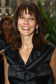 Sophie Marceau's dangling diamond earrings added that light and airy shine her dark outfit needed.