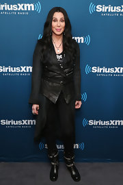 Cher amped up the edge factor in a pair of studded black moto boots and a leather vest during SiriusXM's Town Hall series.