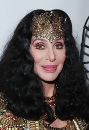 Cher went for a theatrical look with bright eyeshadow and an intricate headband at the Marquee Club in NYC.