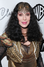 Cher wore her hair in a high-volume curly style, dressed up with a filigree headband, at the Marquee Club in NYC.