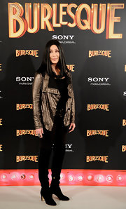 Cher rocked a casual look in a pair of sleek black suede over-the-knee boots. The singer paired the trendy footwear with black skinny pants and a metallic jacket.