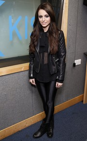 Cher Lloyd went the ultra-edgy route in a black leather jacket layered over a sheer blouse during her visit to the Kiss FM studios.