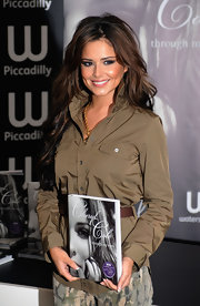 Cheryl wears a soft rose lipstick for her book signing.