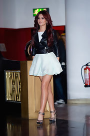 Cheryl paired her tough leather jacket with a mint green Resort 2011 day dress.