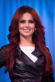 Cheryl Cole showed off her ravishing plum red hair, while unveiling her wax figure in London. The 'X Factor' judge keeps her look fresh by updating her look with fresh hairstyles.