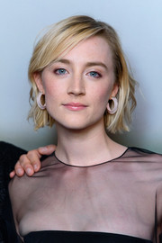 Saoirse Ronan jazzed up her look with a pair of jelly hoops by Alison Lou.