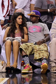 Lil Wayne donned a gray logo tee with his camo cargo shorts for the NBA Playoffs game.