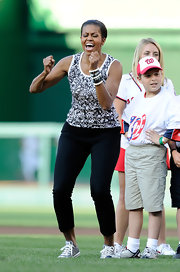 Michelle Obama sported a fab black-and-white ensemble, finished off with layers of beaded bracelets, at the Chicago Cubs versus Washington Nationals game.