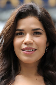 America Ferrera kept her makeup look ultra simple with mascara and a hint of moisturizing, minimal shine lip gloss at a photocall for 'Chicago.'