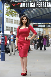 America Ferrera was a vision in red at the Garrick theatre in London. She topped off her figure-flattering red dress with bright velvet red peep-toe slingbacks.