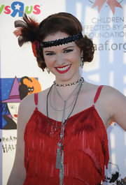 Sarah Drew topped off her 1920s-inspired look with this sequined and feathered head piece.