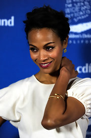 Zoe Saldana wore a melted pave wrap bangle in gold with white CZ.