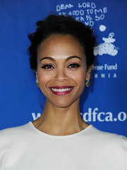 Zoe Saldana wore her hair in a casual bobby pinned updo at The Children's Defense Fund's 21st Annual Beat the Odds Awards.