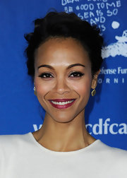Zoe Saldana wore a bright boysenberry lipstick topped with gloss at The Children's Defense Fund's 21st Annual Beat the Odds Awards.
