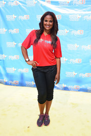 Laila Ali teamed her shirt with a pair of black capris.