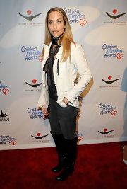 Elizabeth Berkley accessorized her charity gala look by wearing a silk scarf around her neck.