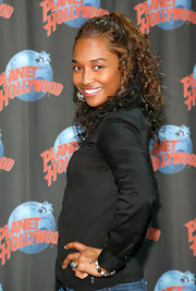 Chilli was all smiles at Planet Hollywood sporting a curly half up hairstyle.