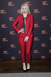 Iggy Azalea chose a vibrant red pantsuit to wear with a print button down at 'The Sound of Change Live.'