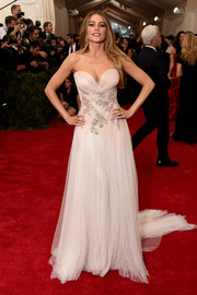 She strayed from the Met Gala theme, but Sofia Vergara definitely knows how to dress for her figure, choosing this cleavage-baring, waist-flaunting strapless gown by Marchesa.