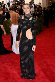 Miley Cyrus took another chance to flaunt some skin in this studded black cutout gown by Alexander Wang during the Met Gala.