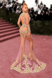 Beyonce channeled Barbie at the Met Gala in her gorgeous sheer beaded gown and genie ponytail.