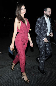Emily Ratajkowski kept it laid-back yet cute in a raspberry-hued jumpsuit while attending a Met Gala after-party.