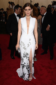 Kate Mara looked subtly seductive at the Met Gala in a cheongsam-inspired Diane von Furstenberg gown featuring a down-to-the-navel plunge and a thigh-high slit.