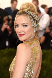 Kate Hudson paired a bedazzled floral headpiece with a sequined gown for a totally enchanting look during the Met Gala.