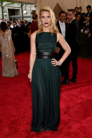 Claire Danes went for edgy elegance at the Met Gala in a dark green Valentino Couture gown accented with a black leather belt.