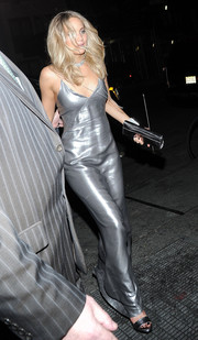 Jennifer Lawrence attended a Met Gala after-party wearing a slinky Galvan slip dress that flowed down her body like liquid silver.