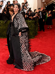 Lady Gaga totally nailed the Met Gala theme with this hanfu-inspired, lattice and feather-embellished gown by Balenciaga.