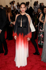 Olivia Munn looked quite the diva in a cold-shoulder, tie-dye gown by J. Mendel during the Met Gala.