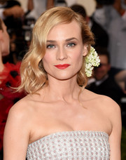 Diane Kruger looked oh-so-beautiful with her flower-adorned, half-pinned waves at the Met Gala.
