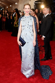 Emily Blunt looked grand in a beaded gray Prada column dress, complete with a navy cape, during the Met Gala.