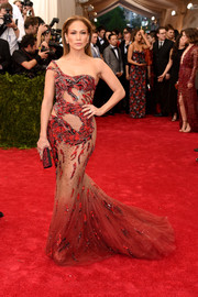 J-Lo's revealing Met Gala gown featured a mermaid silhouette with tulle train.