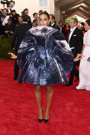 Solange Knowles was all about space-age glamour at the Met Gala in this bold cosmic-print dress by Giles.