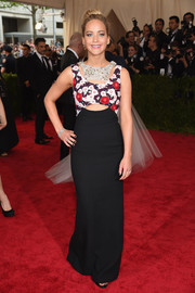 Turning to her favorite, Dior, for her Met Gala red carpet look, Jennifer Lawrence chose this cutout gown featuring a floral bodice and a crystal-embellished neckline.