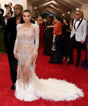 Kim Kardashian looked like a couture bride in her beaded and feathered white gown at the Met Gala.