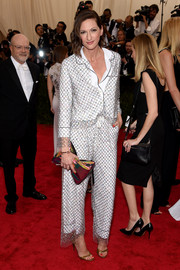 Jenna Lyons wore what looked a white pajamas with a net overlay for her Met Gala look.