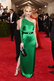 Emma Roberts went for sleek sophistication in a green silk one-shoulder gown by Ralph Lauren at the Met Gala.