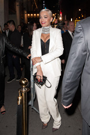 Rita Ora changed out of her slinky Met Gala gown into this white pantsuit, which she styled with a mega-chunky choker, for an after-party.