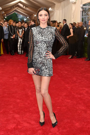 Miranda Kerr sparkled at the Met Gala in a Louis Vuitton sequined mini dress with sheer black sleeves.