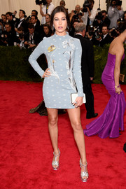 Hailey Baldwin went for a leggy look in a flower-embroidered mini dress by Topshop during the Met Gala.