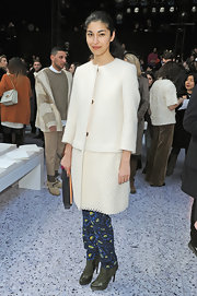 Carolina Issa showed her classic side with a white wool coat but mixed it up a bit with print skinny pants.